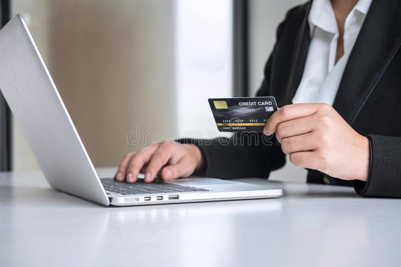 Business woman consumer holding credit card and typing on laptop for online shopping and payment make a purchase on the Internet, royalty free stock image