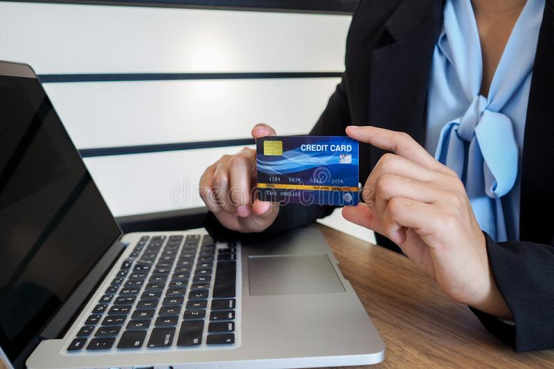 Business woman consumer spending via credit card and internet banking for shopping online.  stock images