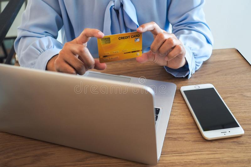 Business woman consumer spending via credit card and internet banking for shopping online.  stock photos