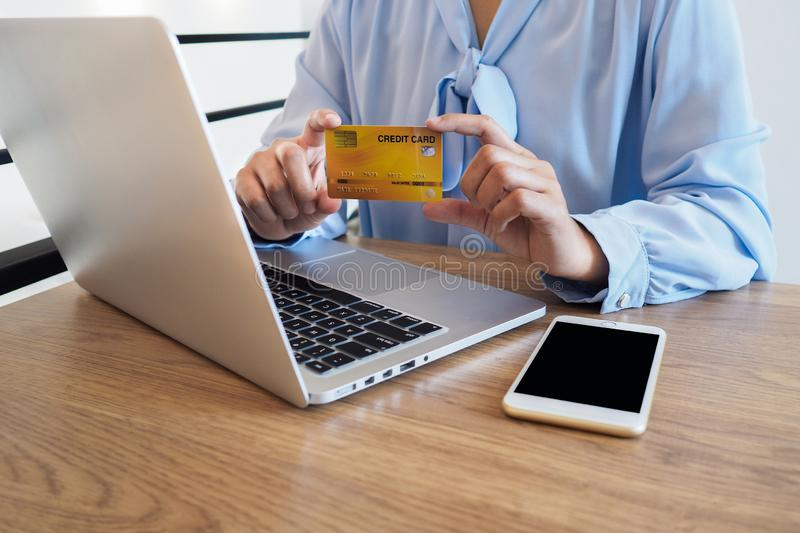 Business woman consumer spending via credit card and internet banking for shopping online.  royalty free stock images
