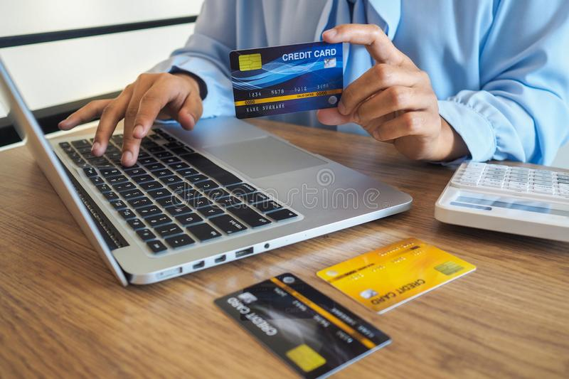 Business woman consumer spending via credit card and internet banking for shopping online.  stock photo