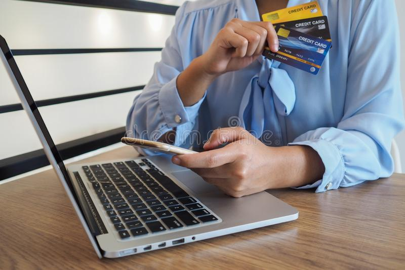 Business woman consumer spending via credit card and internet banking for shopping online.  royalty free stock photography