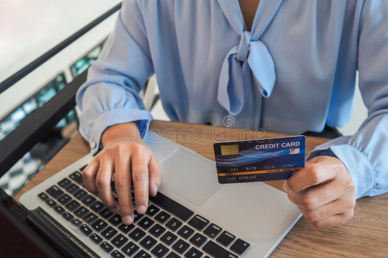 Business woman consumer spending via credit card and internet banking for shopping online.  stock photography