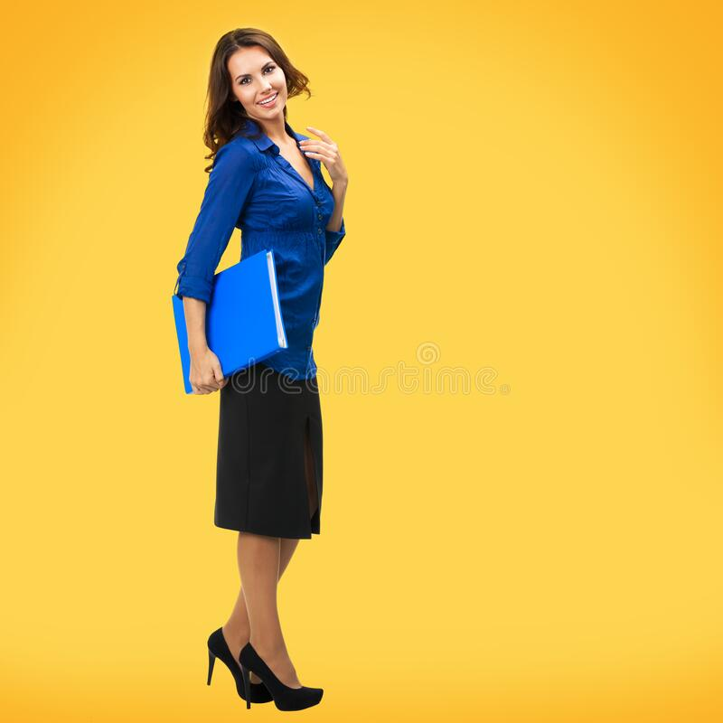 Business woman with copy space, over yellow orange stock image