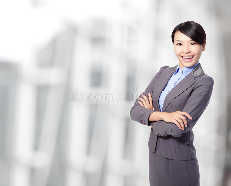 Business woman cross arms at office