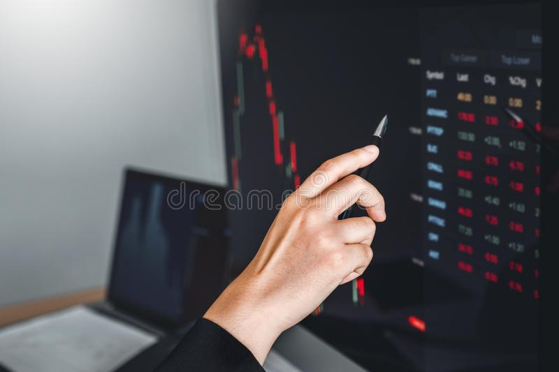 Business woman deal Investment stock market discussing graph stock market trading Stock traders concept.  stock photo