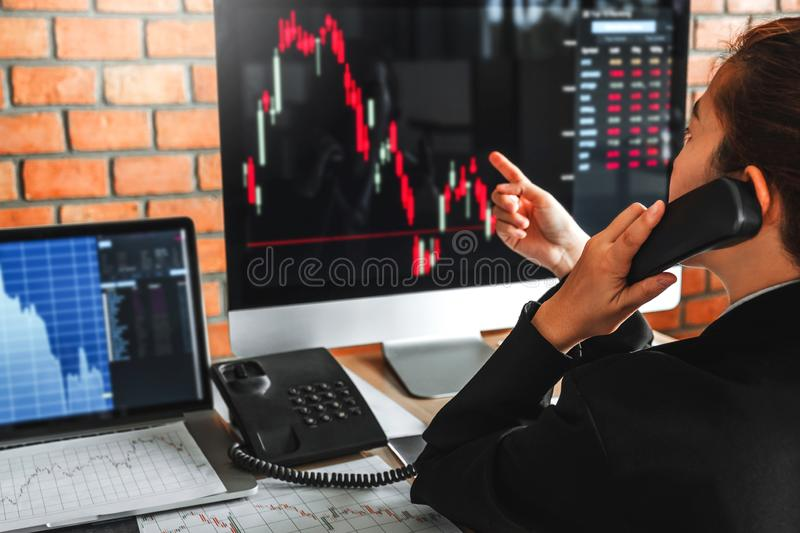 Business woman deal Investment stock market discussing graph stock market trading Stock traders concept.  royalty free stock image