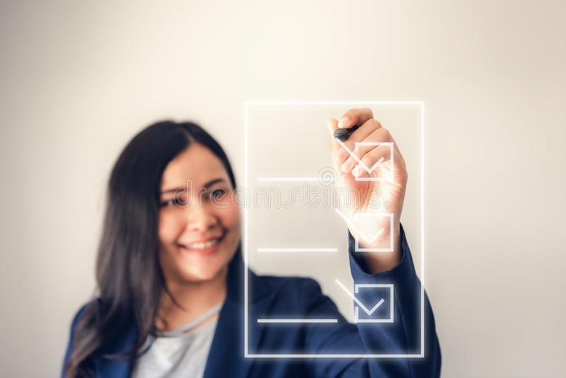 Business Woman is Decision to Checklist Screen Blank Form, Confident Businesswoman Doing Survey Questionnaire While Mark Checkbox royalty free stock photos