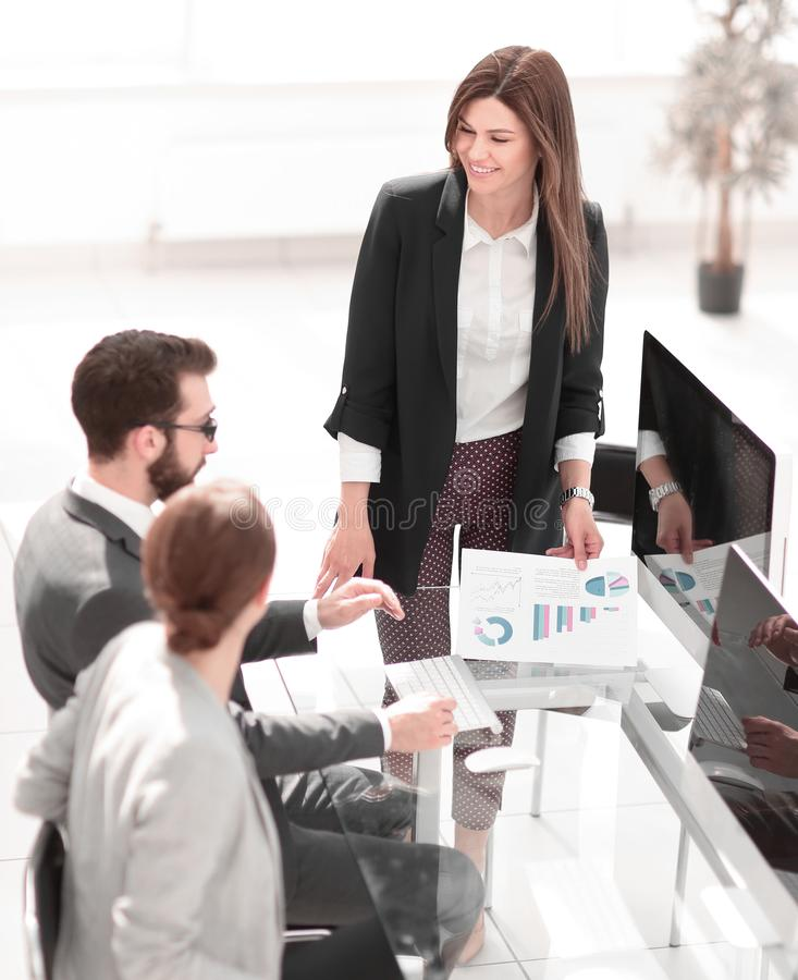 Business woman discusses with the business team financial performance royalty free stock images