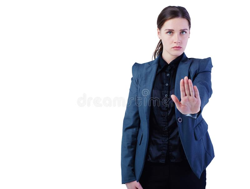 Young business woman do a stop gesture isolated on white background. stock photography