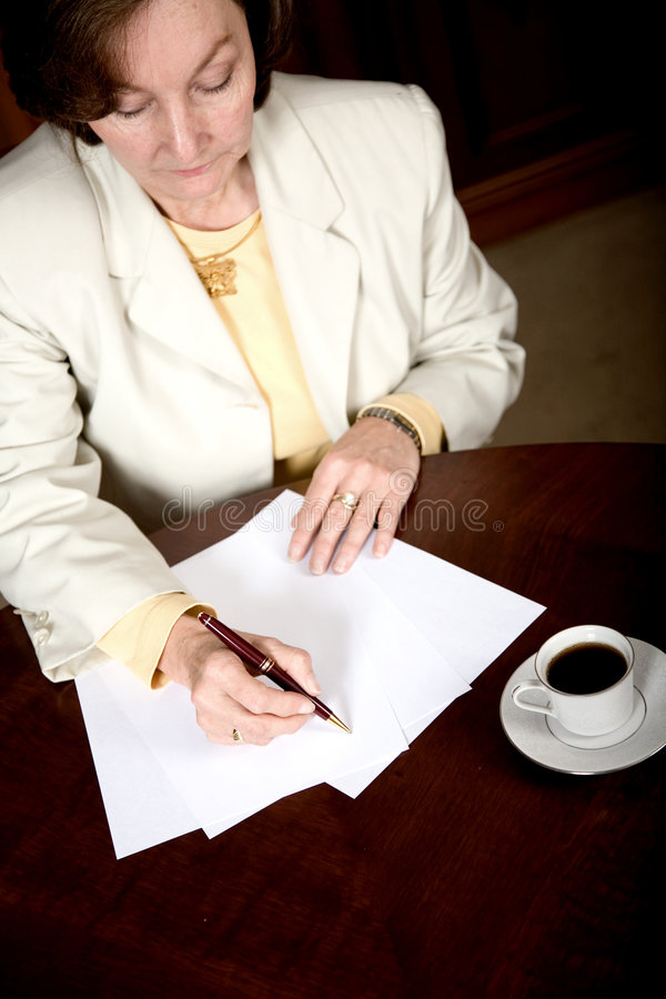 Business woman doing paperwork