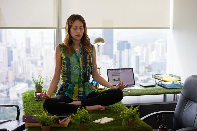 meditation in office. Download Business Woman Doing Yoga Meditation On Table In Office-2 Stock Photo - Image Office