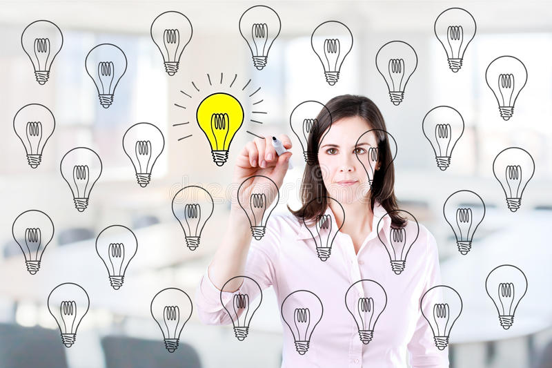 Business woman drawing a great idea concept. Office background. Business woman drawing a great idea concept. Office background stock photo