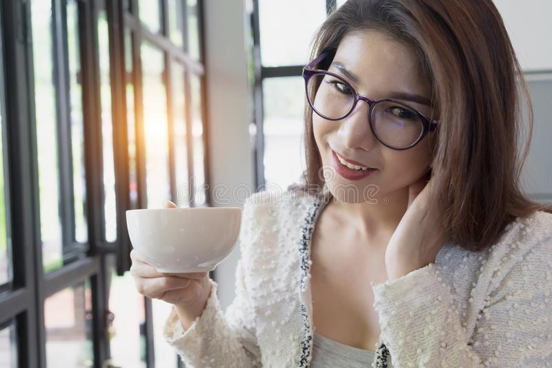 Business woman drinking coffee. Happy young girl holding tea cup stock images