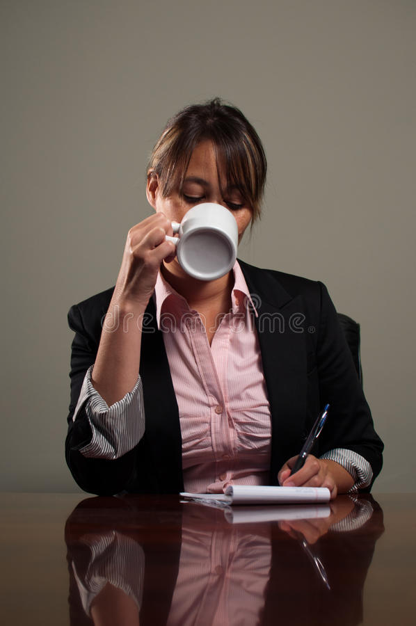 Download Business Woman Drinking Coffee During Meeting Stock Photo - Image: 24913782