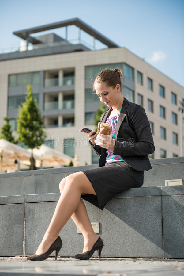 Download Business Woman Eating And Working With Phone Stock Photo - Image: 25148498