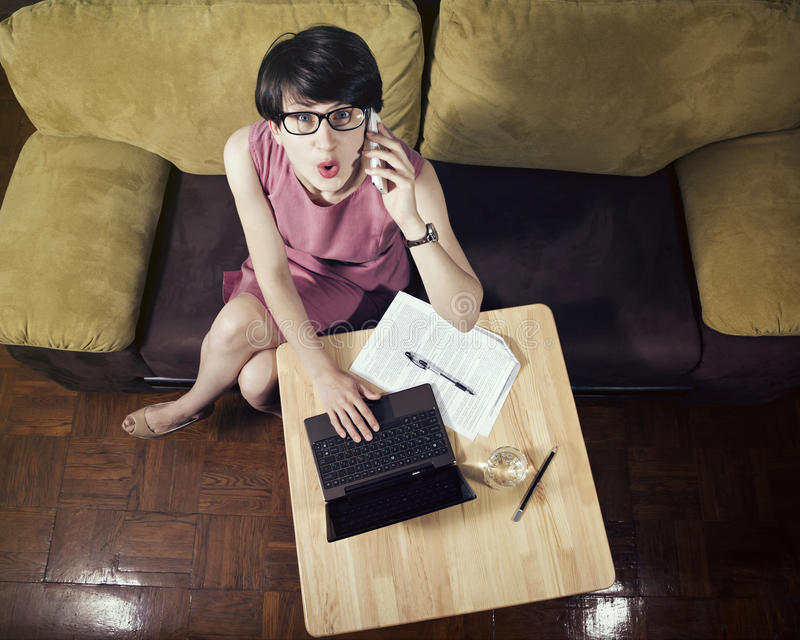 Business woman emotionally talking by smartphone. stock photos
