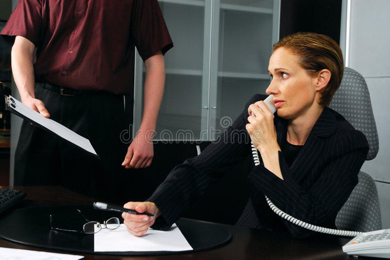 Business woman and employee royalty free stock image