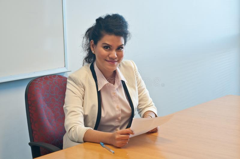 Business woman examining contract agreement in office. And smile with confidence stock image