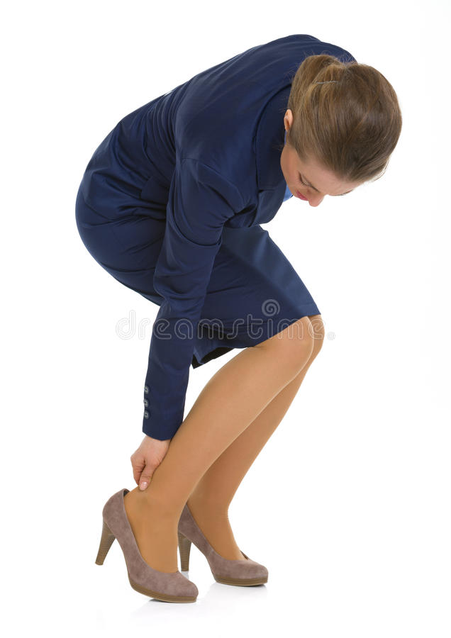 Business woman experiencing pain from shoes. On white stock photo