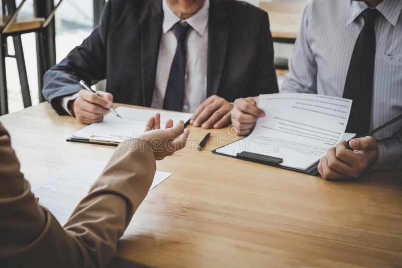 Business woman explaining about his profile to two selection committee manager sitting in during job Interview, interview the job. Business women explaining stock photography