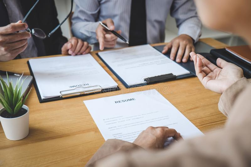 Business woman explaining about his profile to two selection committee manager sitting in during job Interview, interview the job. Business women explaining stock images