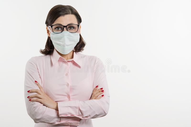 Business woman fears the virus and wears a face mask, white background, copy space. Business woman fears the virus and wears a face mask, white background, copy stock image