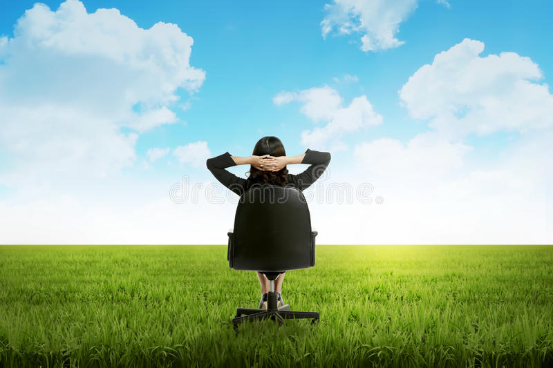 Business woman feeling happy on the meadow stock images