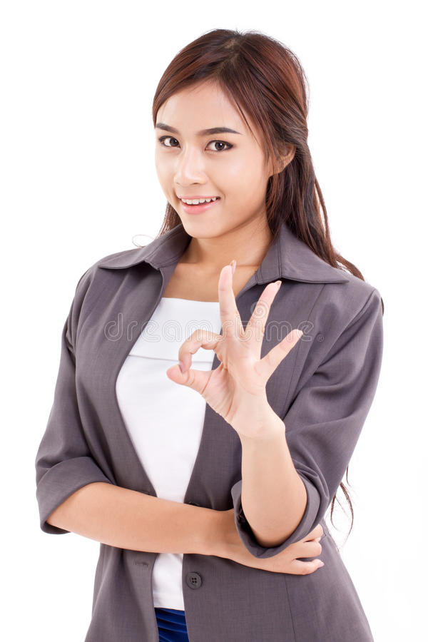 Business woman, female executive giving ok hand sign. Hand gesture on white background royalty free stock photo