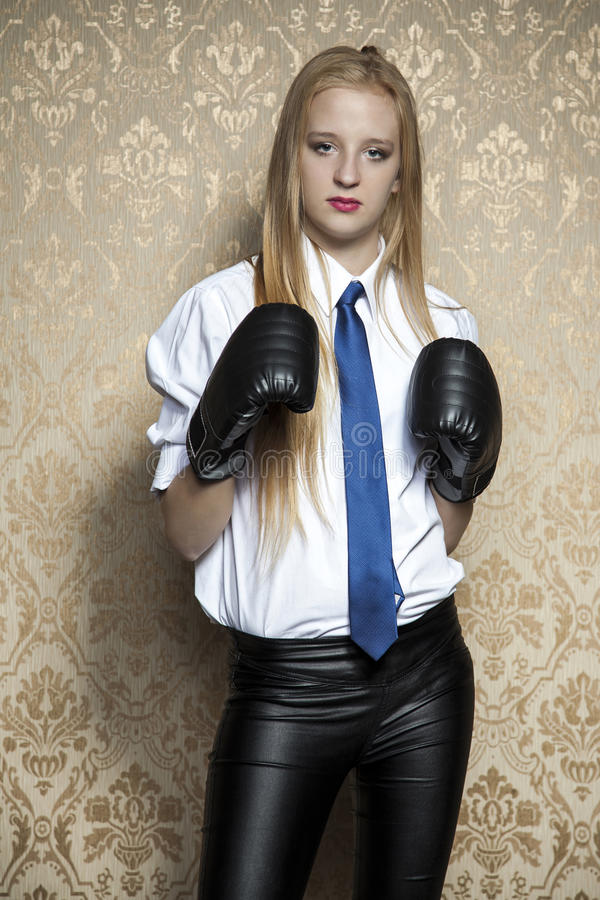 Business woman fighting authorities. Boxing gloves royalty free stock image