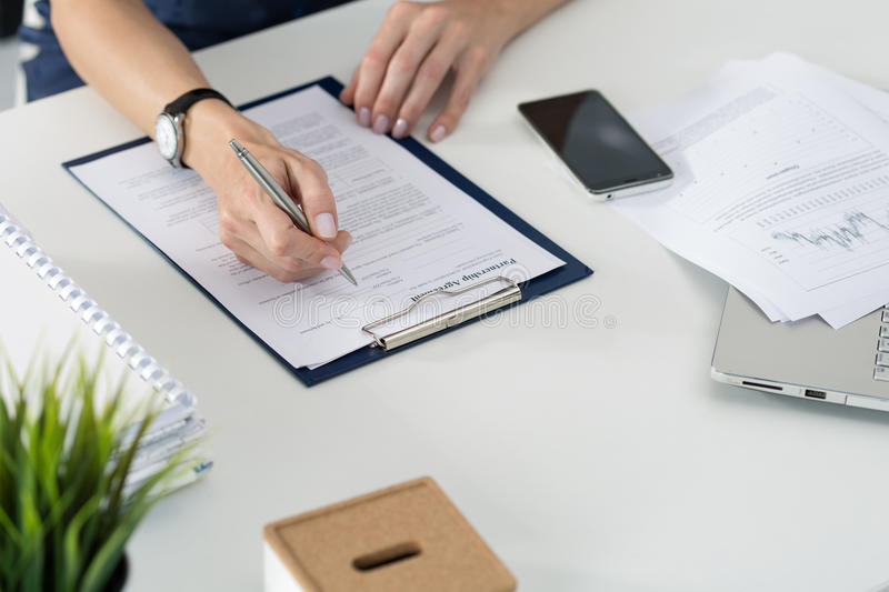 Business woman filling partnership agreement blank. Business and partnership concept stock image