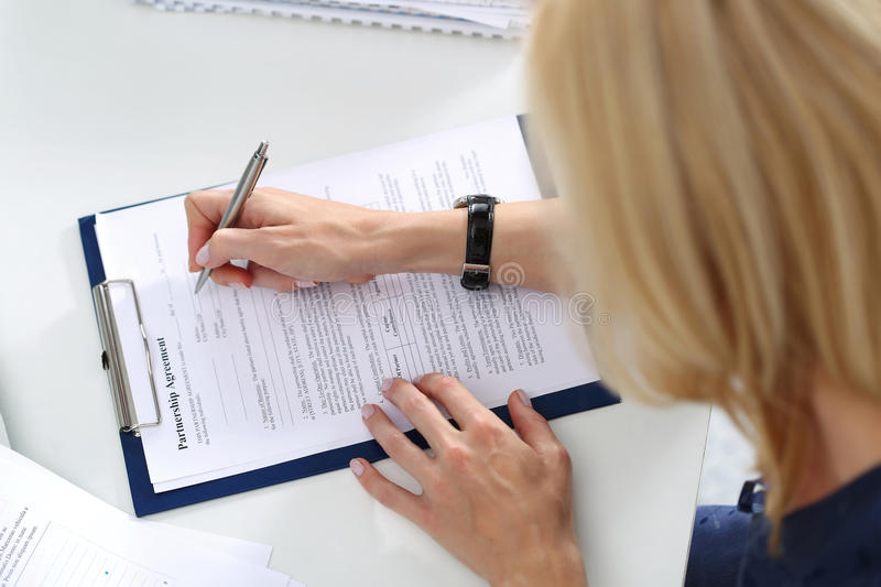 Business woman filling partnership agreement blank. Business and partnership concept royalty free stock photography