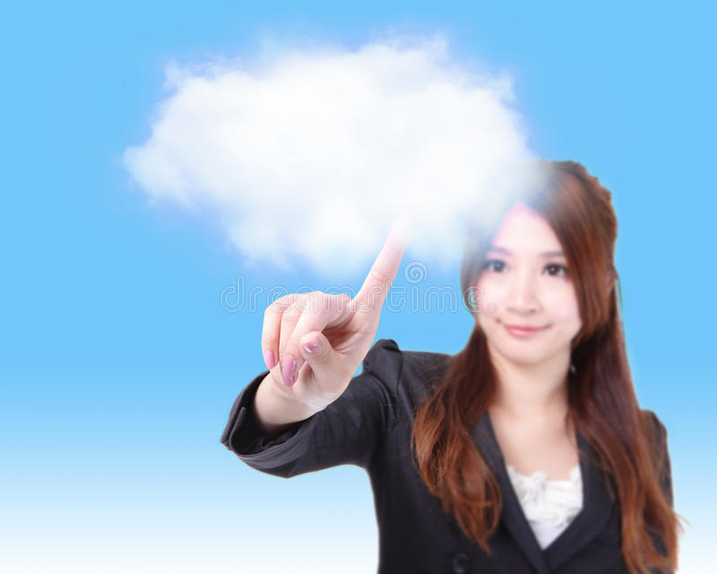 Business woman finger touch cloud. Beautiful Business woman finger touch cloud over blue background, concept for cloud computing, internet, model is a asian girl royalty free stock image