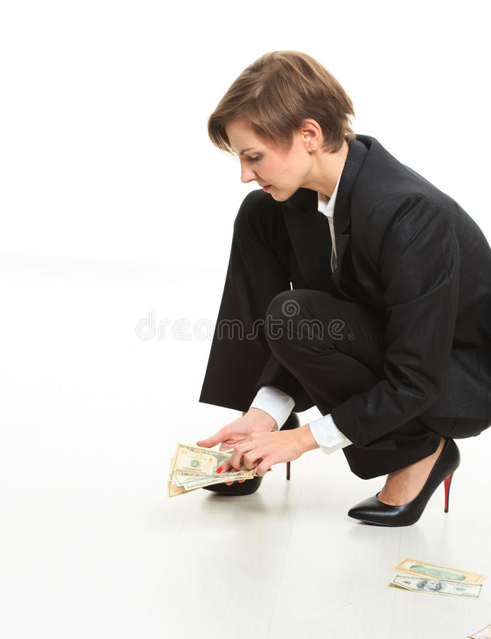 Business Woman On Floor Grabbing Up Cash. royalty free stock images