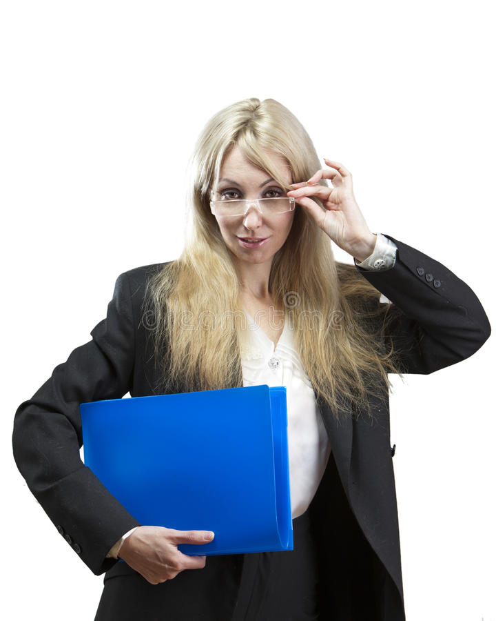 The business woman with folders looks through glasses stock image