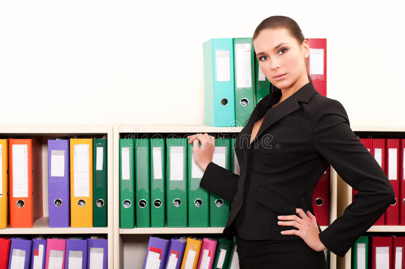 Download Business Woman In Front Of Shelves With Folders Stock Photo - Image: 19710906