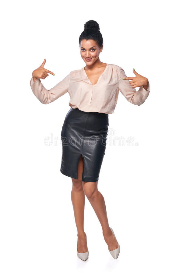 Business woman in full length pointing at herself stock images