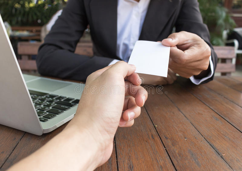 Business woman give business card for customer in coffee shop. stock photography