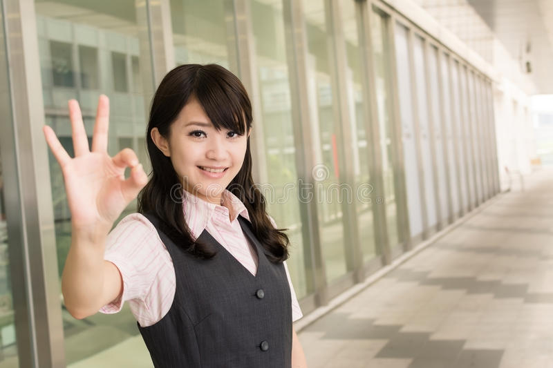 Ok gesture. Business woman give you an Ok sign, closeup portrait in outside of modern city stock photos