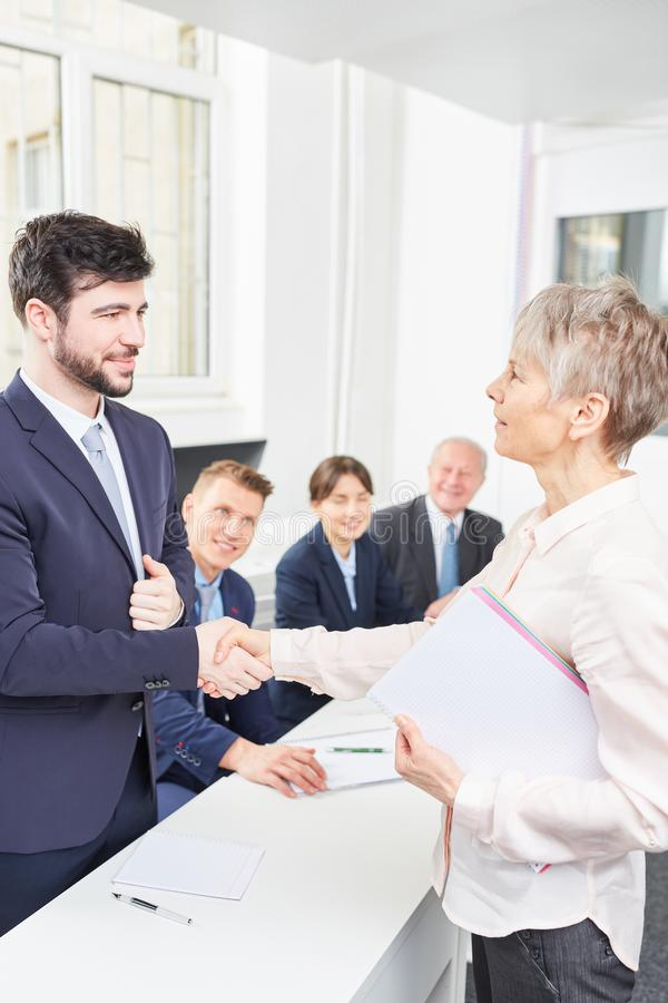 Business woman gives candidate handshake royalty free stock images