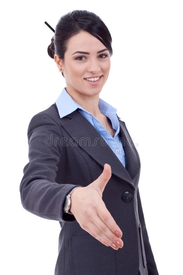Business woman giving hand for handshake. Young happy business woman giving hand for handshake, isolated on white stock photography