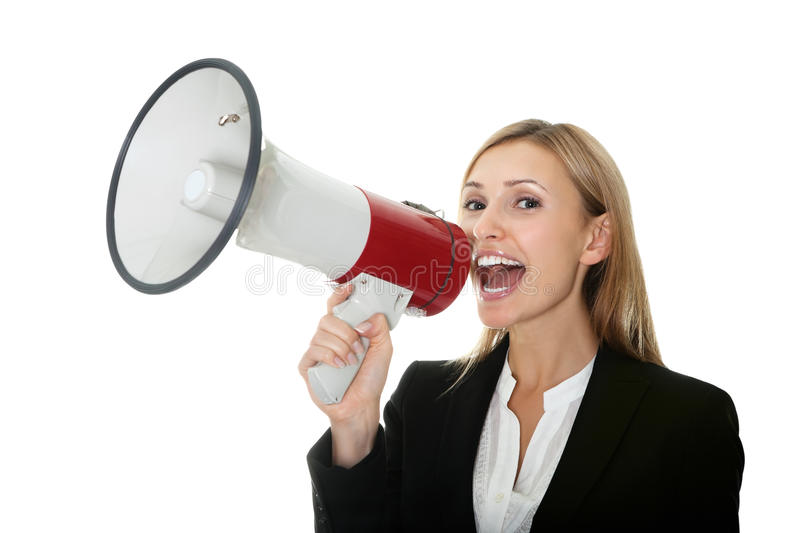Business woman giving instructions with megaphone. Excited young business woman screaming into a megaphone on white background stock images