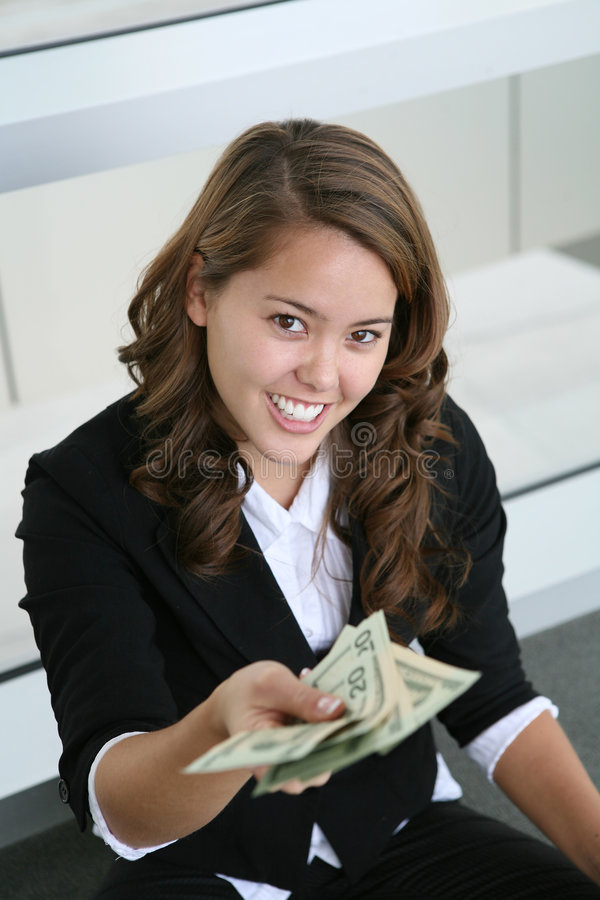 Business Woman Giving Money. A pretty business woman handing some money stock photos