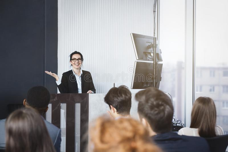 Business woman giving presentation at conference room stock image