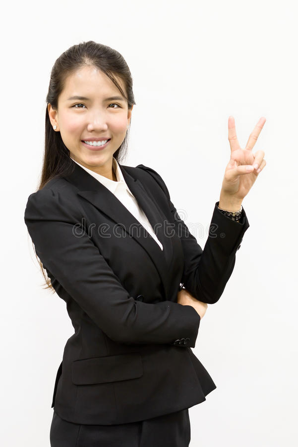 Business woman giving victory. Thai business woman giving victory sign royalty free stock image