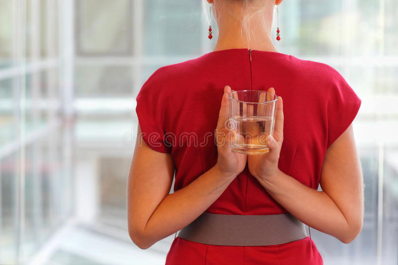 Business woman with glass of water - healhy lifestyle royalty free stock images