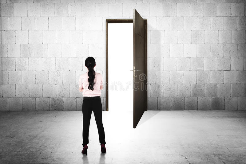 Business woman going to the open door royalty free stock image