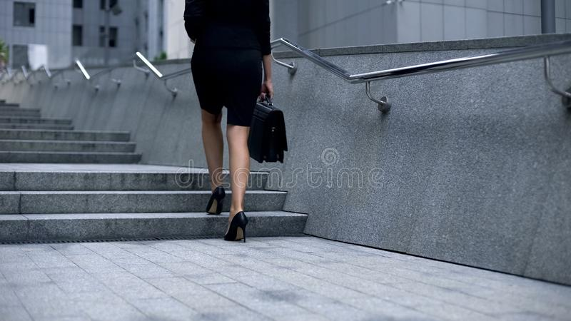 Business woman going upstairs, climbing career ladder, achieving goals and aims royalty free stock images