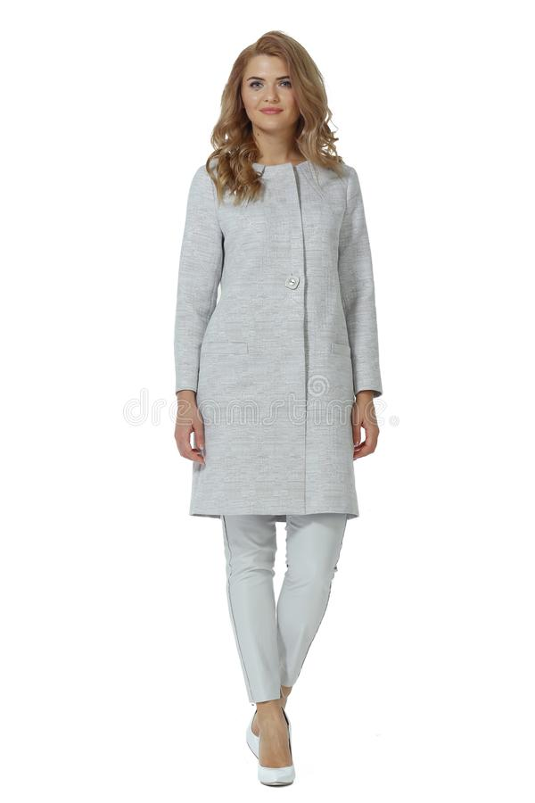 Business woman in gray woolen coat trousers white stiletto high heels shoes. Full body photo isolated on white stock photography