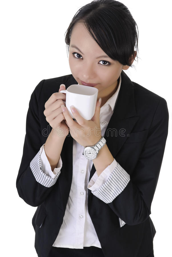 Business woman grin. With joy and hold cup of coffee, closeup portrait on white background stock image